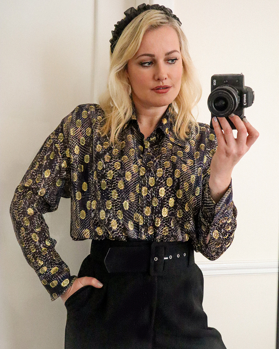 Lorna Weightman wearing Massimo Dutti printed shirt holding a camera