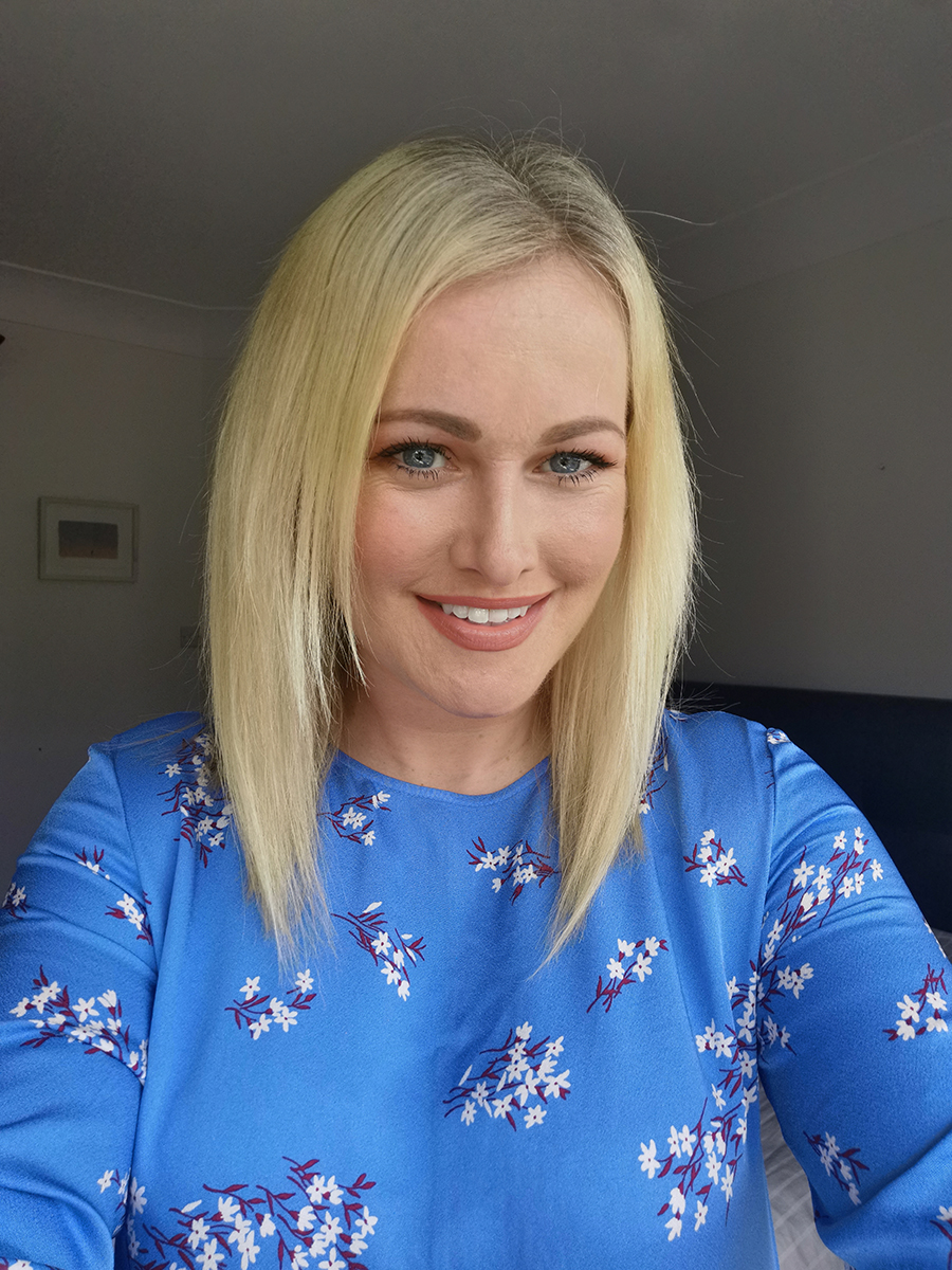 Lorna Weightman wearing a blue dress with flowers