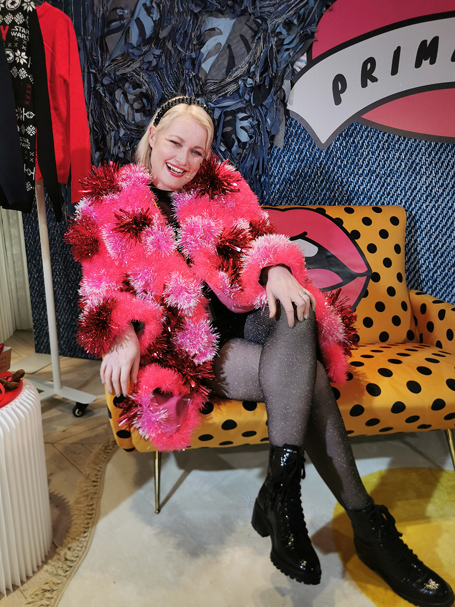 Lorna Weightman wearing pink tinsel jacket designed by Jen Nollaig