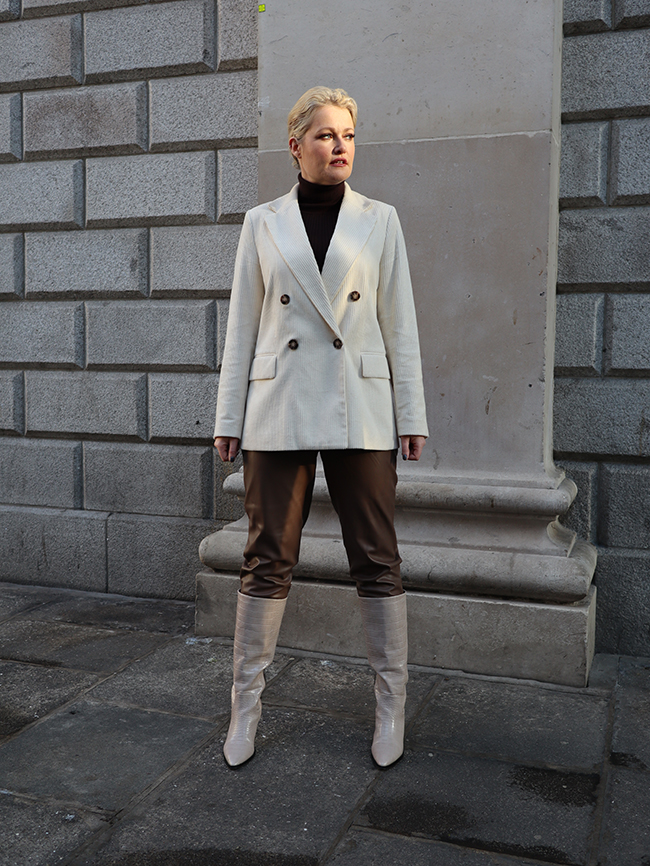 Lorna weightman pictured wearing cream jacket, leather trousers and cream boots
