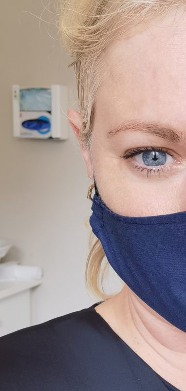 Close up image of Lorna Weightman wearing a blue face covering