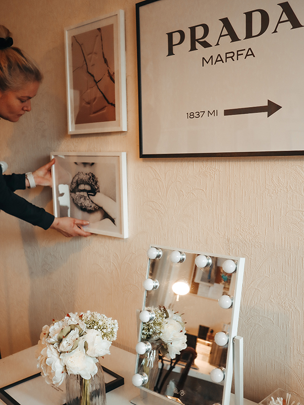 Image of wall art being hung on a white wall