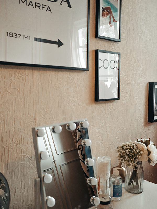 Image of wall art and desk with mirror sitting on it