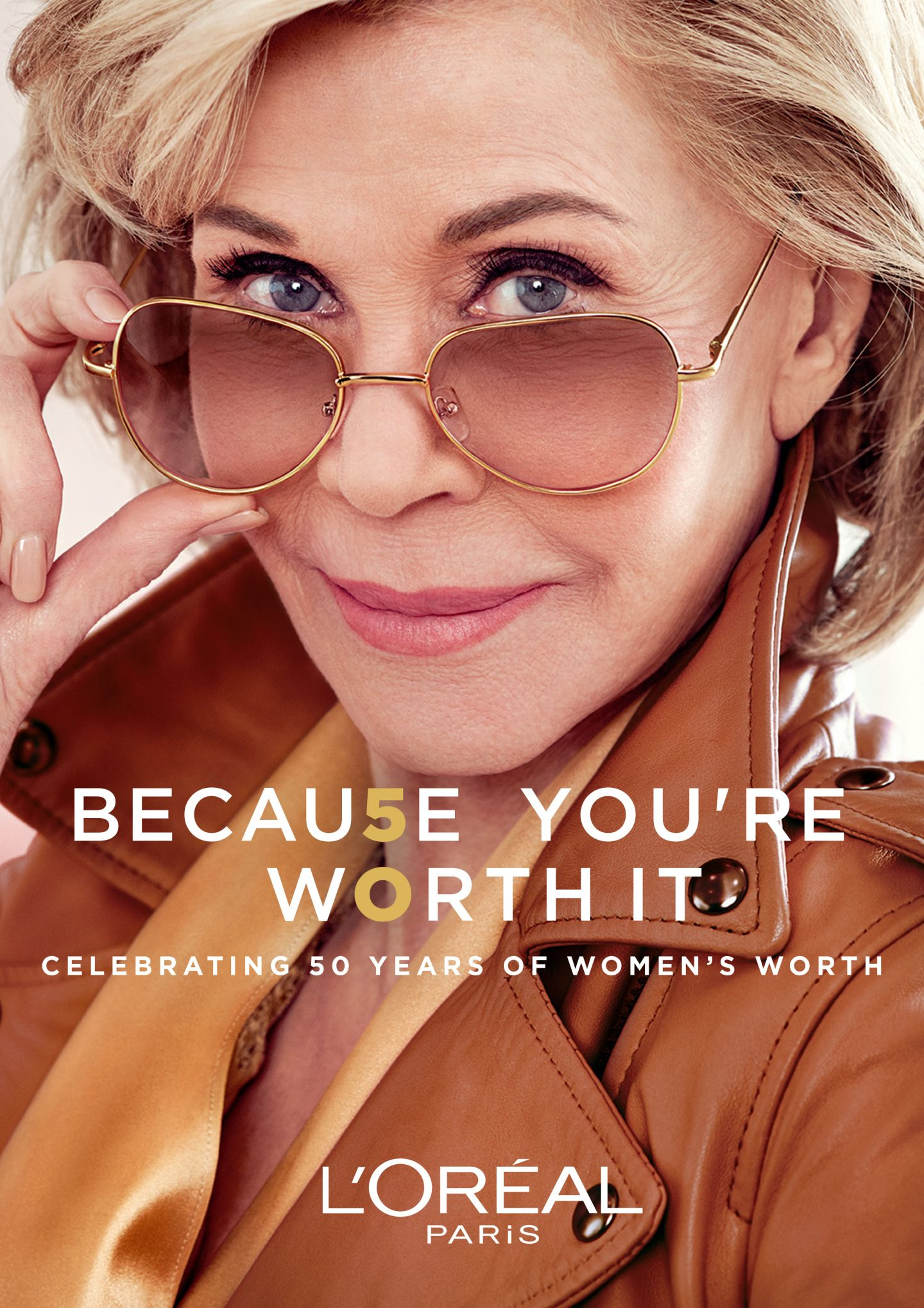 Jane Fonda wearing sunglasses and a light brown coat in a L'Oreal Paris advert